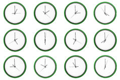 Empty 12 clocks - No digits. 12 clocks isolated on a white background. Each one showing one hour of the day without printed numbers Stock Photography