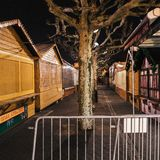 Empty closed christmas market stalls in Strasbourg after attacks. Square image of closed Christmas Market stalls chalets after terrorist attack of Cherif Chekatt stock images