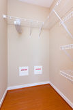 Empty closet. Empty walk-in closet with a wooden floor royalty free stock photography
