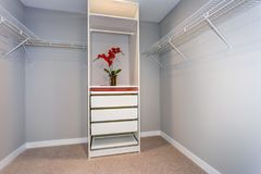 Empty closet interior with shelves and white cabinet. View of empty closet interior with shelves and white cabinet stock photo