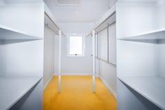 Empty closet. Empty walk-in closet with a small window royalty free stock photo