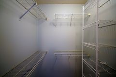 Empty clothes closet with shelves. Before a move in Stock Photo