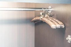 Empty clothes hanger in closet Royalty Free Stock Images