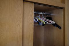 Empty clothes hangers in the closet. Day stock images