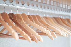 Empty clothes hangers lined up in a room Royalty Free Stock Image