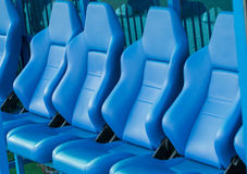 Empty coach and reserves blue bench on a football stadium Royalty Free Stock Photo