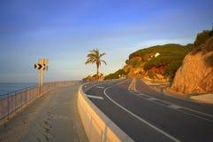 Empty coastal road Stock Photos