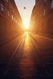 Empty cobblestone street in old town at sunset. Royalty Free Stock Photo