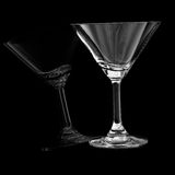 Empty cocktail glass on black Royalty Free Stock Photos