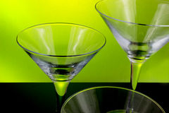 Empty cocktail glasses. Pair of glasses on green background Stock Photo
