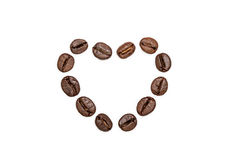 Empty coffee beans heart shape Royalty Free Stock Photos