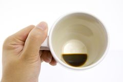 Empty coffee cup. Hand holding an empty coffee cup isolated on white background Royalty Free Stock Photos