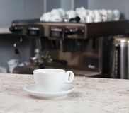 Empty coffee cup on the bar Royalty Free Stock Photo