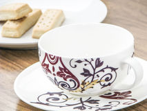 Empty coffee cup and biscuits Stock Images