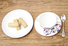 Empty coffee cup and biscuits Stock Photo