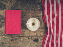 Empty coffee cup and book on wood Royalty Free Stock Photos