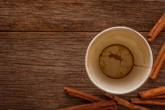 Empty coffee cup with Cinnamon after drink on wood table. Empty coffee cup with Cinnamon after drink on woodden table Stock Images