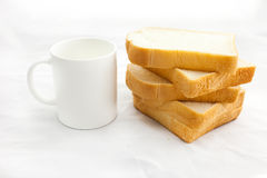 Empty coffee cup or coffee mug and sliced bread isolated on whit Stock Image
