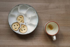 Empty coffee cup and cookie tin Royalty Free Stock Image