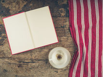 Empty coffee cup and open book Stock Images