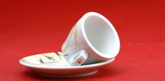 Empty coffee cup on red Stock Photography