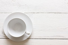 Empty coffee cup and saucer on rustic painted wood. From above. Stock Images