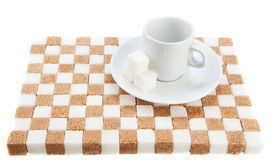 Empty coffee cup on a saucer with three cubes of sugar on a stan. D of brown and white sugar. Isolated on white Stock Image