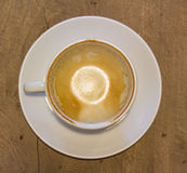 Empty coffee cup on table at coffee shop Royalty Free Stock Photos