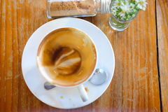 Almost empty coffee cup. On wood table royalty free stock photography