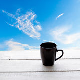 Empty coffee cup on a wooden table over white back Royalty Free Stock Photo