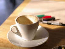 Empty coffee cup with working background Stock Photography