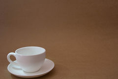 Empty coffee cups. Brown background Royalty Free Stock Photo