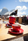 Empty coffee cups on outdoor cafe table Royalty Free Stock Photo