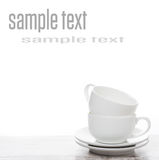 Empty coffee cups on a white table and space for text Stock Photo