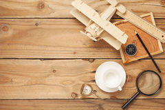 Empty coffee cups,Wood airplane, compass,pocket watch,ruler and Royalty Free Stock Image