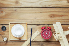 Empty coffee cups,Wood airplane, compass,pocket watch,ruler and Royalty Free Stock Photo