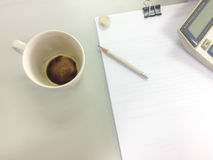 Empty coffee mug with pencil paper calculator. After a break Start work Royalty Free Stock Photos