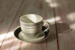 An empty  coffee or tea cup  place on old wooden table. An empty coffee or tea cup Stock Photos
