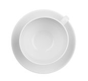 Empty coffee or tea cup top view isolated. Whole cup and saucer are both in focus royalty free stock image