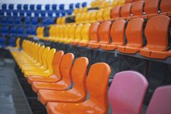 Empty colored chairs at the stadium stock photo