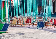 Empty colored seats of carousel royalty free stock images