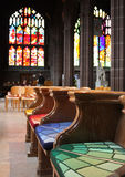 Empty colorful benches of church Royalty Free Stock Photography
