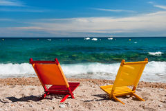 Empty colorful chairs at the beach Royalty Free Stock Photos