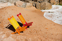 Empty colorful chairs at the beach Stock Image