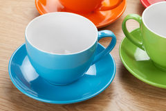 Empty colorful coffee cups Stock Photos
