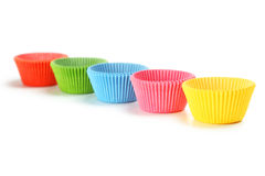 Empty colorful cupcake cases isolated on a white Stock Photography