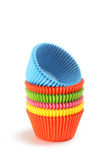 Empty colorful cupcake cases isolated on white background Royalty Free Stock Photography