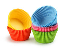 Empty colorful cupcake cases isolated on white background Royalty Free Stock Images
