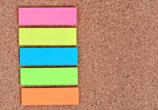 Empty colorful notes on cork background. Empty five colorful notes on cork background Stock Images