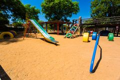 Empty Colorful Preschool Playground slide. Newcastle, South Africa - February 12 2015: Empty Colorful Preschool Playground stock photo